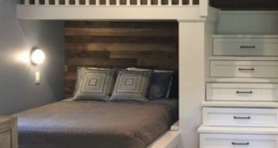 LOVE the shiplap rustic wall and the bunk storage in the stairs for the lake hou...